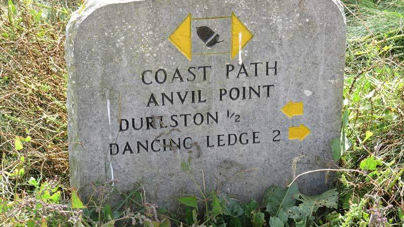 A Busman's holiday. Coast path sign near Durlston © Colin Church