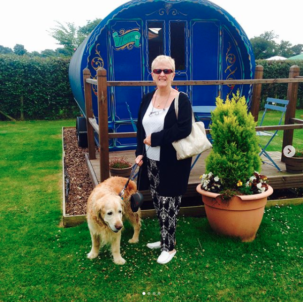 One of guests in front of one of our Romany Caravans