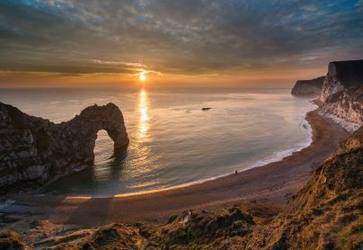 The stunning scene of Durdle Door not far from South Lychett Manor Caravan and Camping Park